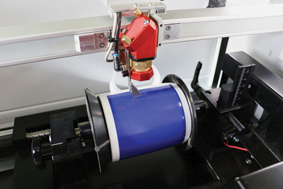 Most laser manufacturers offer a cylindrical engraving attachment for their lasers. Photo courtesy of Trotec Laser, Inc.
