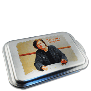 This sublimation-receptive cake pan lid makes an ideal personalized gift. Photo courtesy of Johnson Plastics.