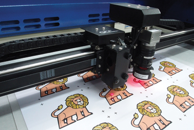 Laser manufacturers, such as GCC America, Inc., offer optical recognition systems for cutting preprinted items with a laser.