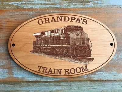 Hobbyists make up an interesting market for a variety of personalized gifts. A personalized wooden sign, such as this one from Mr. Train, is perfect for the unique railroader