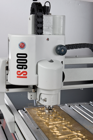 "The IS900 rotary engraving machine from Gravograph has a large 20"" x 28"" T-slot table for applications such as large signs."
