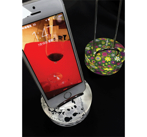 These colorful cell phone stands were printed with a UV printer from GCC America, Inc.