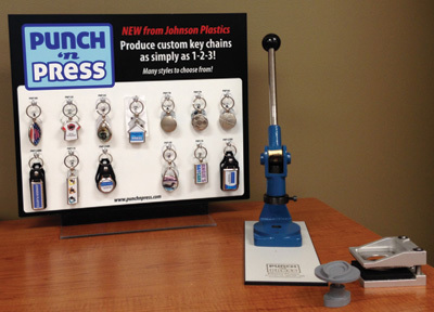 The Punch'nPress from Johnson Plastics Plus is an ideal POP marketing tool for selling custom key chains to impulse buyers.