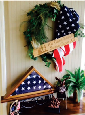 If there is a military base close by, patriotic displays work beautifully. This Veterans Day display in the Awards South showroom features laser engraving on a patriotic wreath, a flag case and eagles.