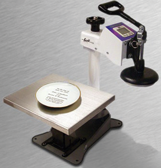There are a variety of different attachments available for heat presses that allow printing on specific items like dinner plates. Photo courtesy of Geo Knight & Co., Inc.