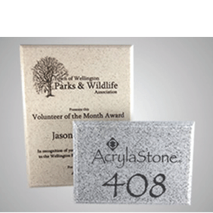 These plaques are made of AcrylaStone and have been paint filled. Available from AcrylaStone and PDU/CAT.