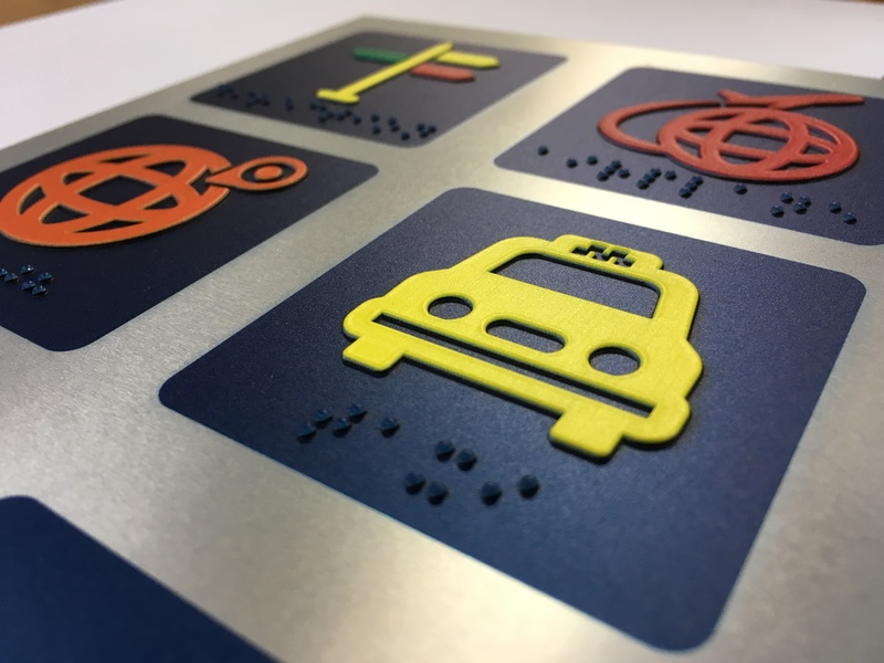 This example from GCC America, Inc. shows a raised pictogram and Braille created with a UV printer.
